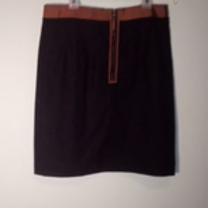 Wool, straight line, pleated, thighlength skirt